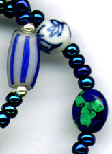 Close up photo of blue beads in a necklace.